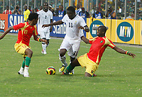 Photo: Steve Bond/Richard Lane Photography.<br />Ghana v Guinea. Africa Cup of Nations. 20/01/2008. Sulley Muntari (C) is tackled