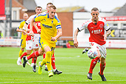 Joe Pigott of AFC Wimbledon (39) and Peter Clarke of Fleetwood Town (4) in action during the EFL Sky Bet League 1 match between Fleetwood Town and AFC Wimbledon at the Highbury Stadium, Fleetwood, England on 10 August 2019.