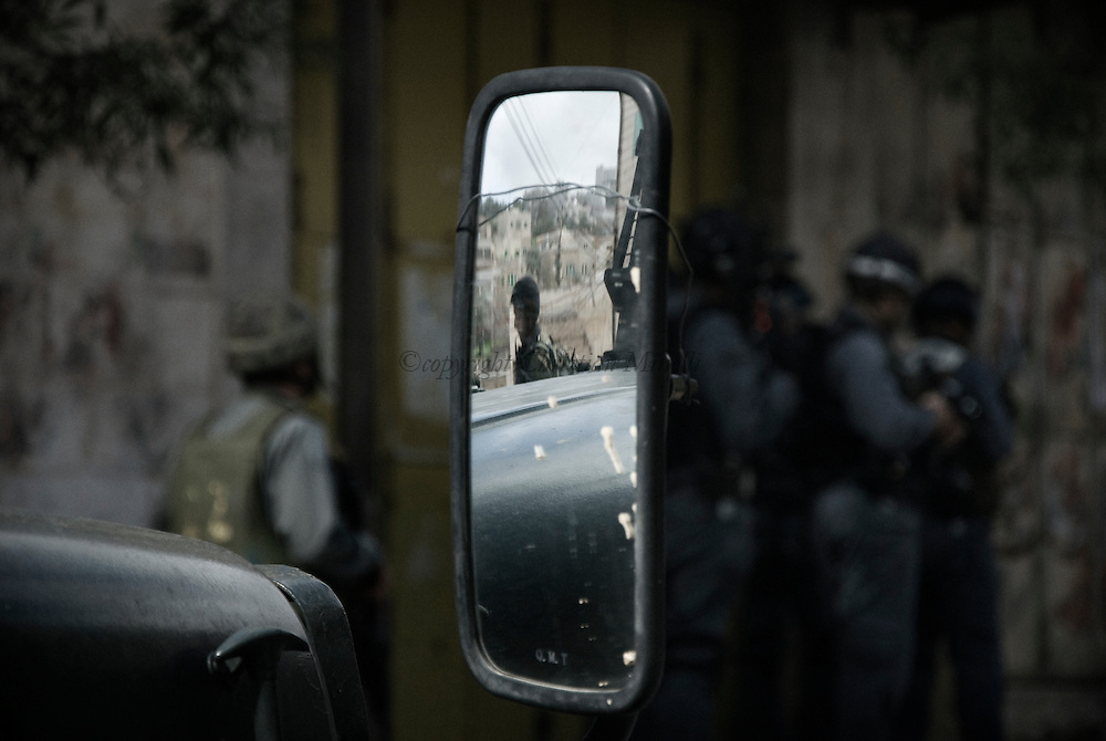 Israeli soldiers patrol the centre of the West Bank city of Hebron February 12, 2010. Palestinians clashed with Israeli troops in Hebron amid outrage over Israel's plan to restore two flashpoint Jewish holy sites in the occupied territory.