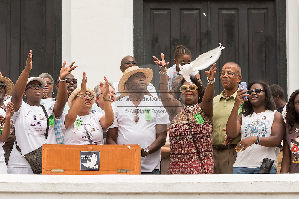 Family members of the Charleston Nine release doves during a memorial service at the Mother Emanuel African Methodist Episcopal Church on the anniversary of the mass shooting June 18, 2016 in Charleston, South Carolina. Nine members of the church community were gunned down during bible study inside the church on June 17, 2015.
