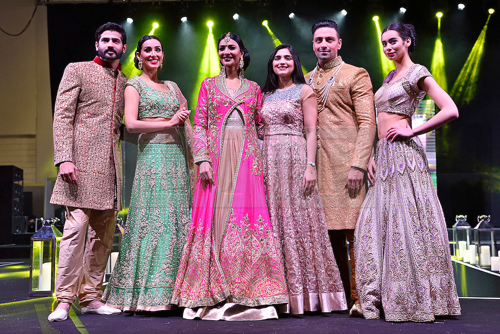 © Licensed to London News Pictures. 27/03/2016. Models on a catwalk stage wearing bride dresses at the Asian Bride Live Wedding Show featuring fashion, beauty and services for brides to be. London, UK. Photo credit: Ray Tang/LNP