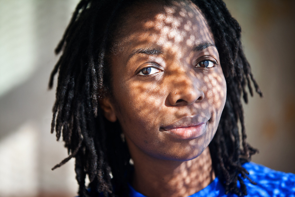 "Ruth Marimo, a native of Zimbabwe and mother of two, poses for a portrait as she cleans a condominium in downtown Omaha on Tuesday, Feb. 19, 2013. Marimo, whose ex-husband turned her into into immigration officials, spent a month in jail awaiting deportation, but was freed and allowed to stay in the United States. She has written ""Freedom of an Illegal Immigrant,"" a book about her experiences. 