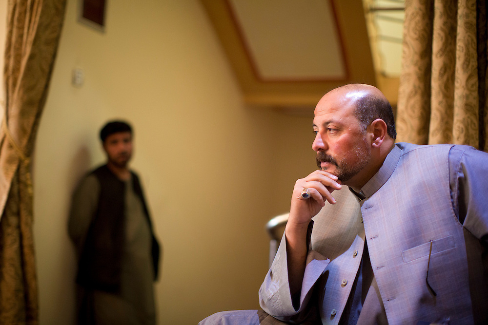March 23, 2014 - Kandahar, Afghanistan - Hashmat Karzai, cousin of Afghan President Hamid Karzai at his home in their historic village of Karz near Kandahar, Afghanistan.<br /> Karzai looks into the distance, pondering a question of national politics.