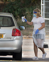 © Licensed to London News Pictures. 19/09/2020. Chessington, UK. A patient receives instructions during a swab test at a Covid-19 testing centre set up in the car park of Chessington World of Adventures south west of London. The Government have faced criticism over delays in getting tested for the COVID-19 strain of coronavirus. . Photo credit: Peter Macdiarmid/LNP
