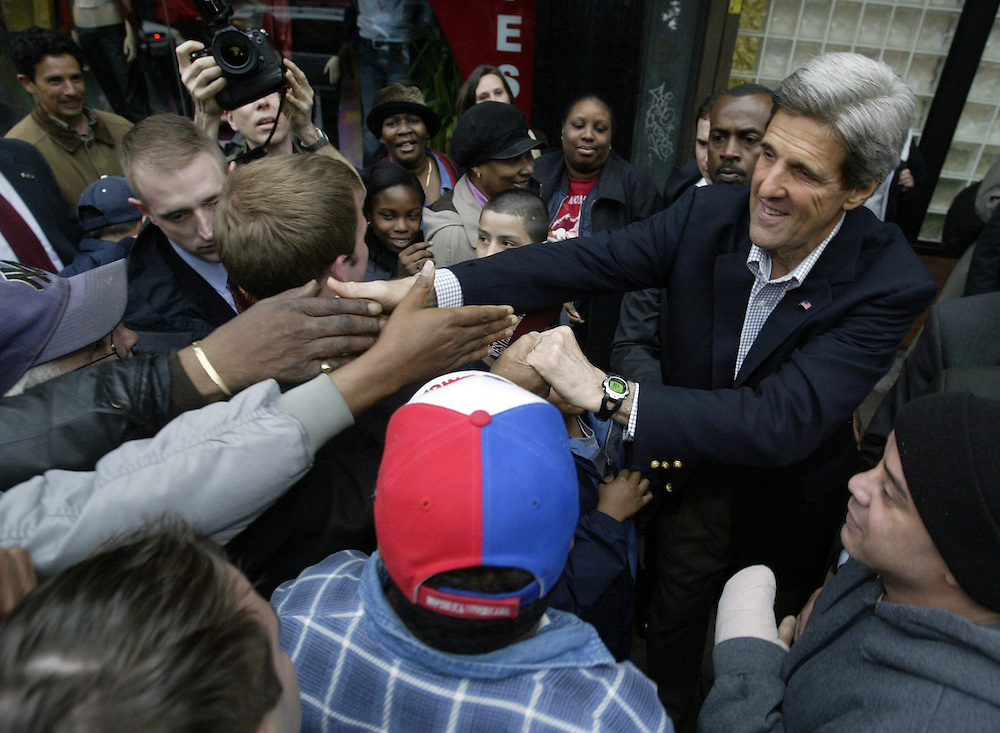 United States Senator and Democratic Presidential candidate John Kerry shakes hands with passers by after a book reading at a day care center on the upper west side of New York City. Wednesday 14 April 2004. EPA/ANDREW GOMBERT