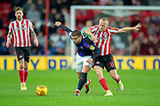 Elliot Lee (#10) of Luton Town FC holds off Dylan McGeouch (#8) of Sunderland AFC during the EFL Sky Bet League 1 match between Sunderland AFC and Luton Town at the Stadium Of Light, Sunderland, England on 12 January 2019.