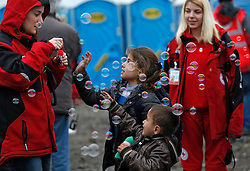 Children play with bubbles blown by volunteers as migrants and refugees are registered by the authorities before continuing their train journey to western Europe at a refugee transit camp in Slavonski Brod, Croatia, February 10, 2016. REUTERS/Darrin Zammit Lupi MALTA OUT. NO COMMERCIAL OR EDITORIAL SALES IN MALTA - RTX26C7B