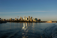 Sydney CBD at sunrise leaving Circular quay, Australia.