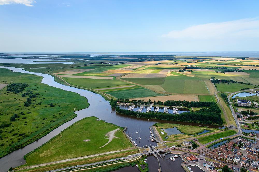 Nederland, Groningen, Gemeente  De Marne, 05-08-2014; Zoutkamp met zeesluis en jachthaven. Voormalig vissersdorp gelegen aan de monding van het Reitdiep in de Lauwerszee, bekend van Heiploeg Garnalen.<br /> Former fishing village, known for Heiploeg Shrimps, port and marina on the Reitdiep, near Lauwers Lake, former Lauwers Sea<br /> <br /> luchtfoto (toeslag op standard tarieven);<br /> aerial photo (additional fee required);<br /> copyright foto/photo Siebe Swart