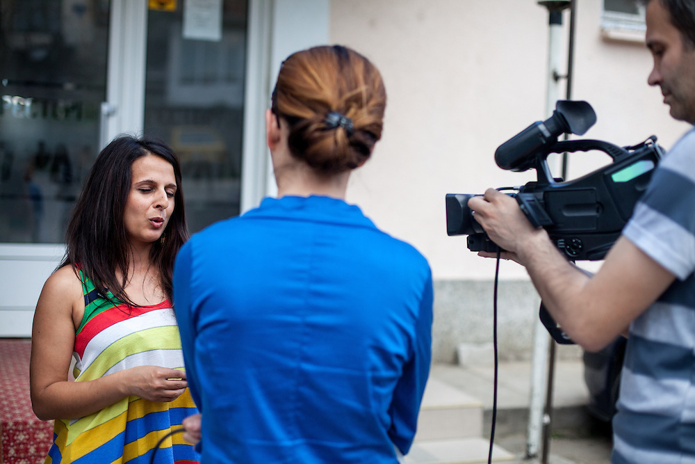 "Paralegal Romina Kajtazova being interviewed by the local television in Delcevo before a meeting with the institutions about ""Patients Rights of the Roma"" in a restaurant in Delcevo, Macedonia."