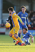 Dannie Bulman of AFC Wimbledon and Andy Barcham of AFC Wimbledon during the Sky Bet League 2 match between AFC Wimbledon and Mansfield Town at the Cherry Red Records Stadium, Kingston, England on 16 January 2016. Photo by Stuart Butcher.