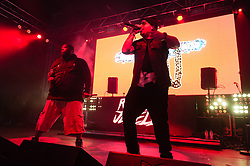 © Licensed to London News Pictures. 06/06/2015. London, UK.   Run the Jewels performing live at Field Day Festival Saturday Day 1.   In this picture - El-P (right), Killer Mike (left).  Run the Jewels is an American hip hop duo composed of  rapper/music producer El-P and rapper Killer Mike.  Photo credit : Richard Isaac/LNP