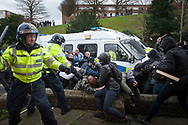 "Dover, Kent, UK. 30th January, 2016. Far right and anti fascist groups clash in the centre of Dover with projectiles being exchanged between the two opposing sides. Far-right groups from across converge on the coastal town of Dover for an anti-refugee protest. The groups including the National Front, SouthEast Alliance, NorthWest Infidels, East Kent English Patriots of  are attempting to highlight the ""migrant crisis"" by marching through the Kent town. As a response a large group of pro immigration groups staged a counter- protest. Pictured:  // Lee Thomas, Flat 47a Park East Building, Bow Quarter, London, E3 2UT. Tel. 07784142973. Email: leepthomas@gmail.com. www.leept.co.uk (0000635435)"