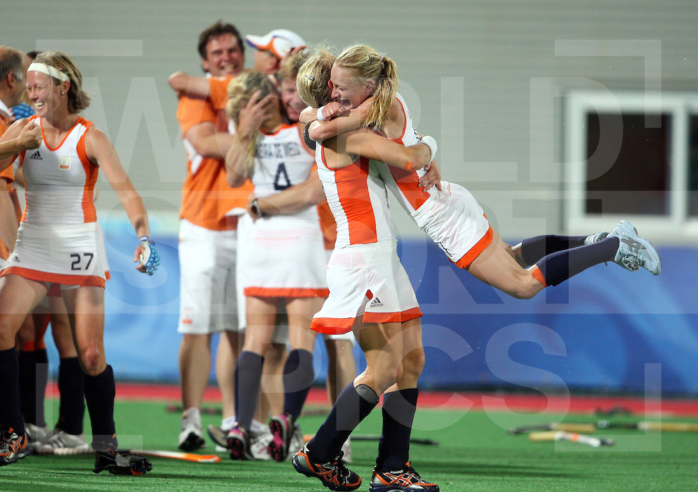 Janneke Schopman (L) hugs Maartje Goderie (R) in  celebration at winning gold,  Netherlands win Gold against china in the Womens hockey at the ..Beijing Olympic Green Hockey Stadium  22-8-08..Photo: Grant Treeby/WSP