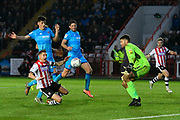 Lee Martin (7) of Exeter City goes down in the box after a challenge by Jacob Greaves (26) of Cheltenham Town during the EFL Sky Bet League 2 match between Exeter City and Cheltenham Town at St James' Park, Exeter, England on 16 November 2019.