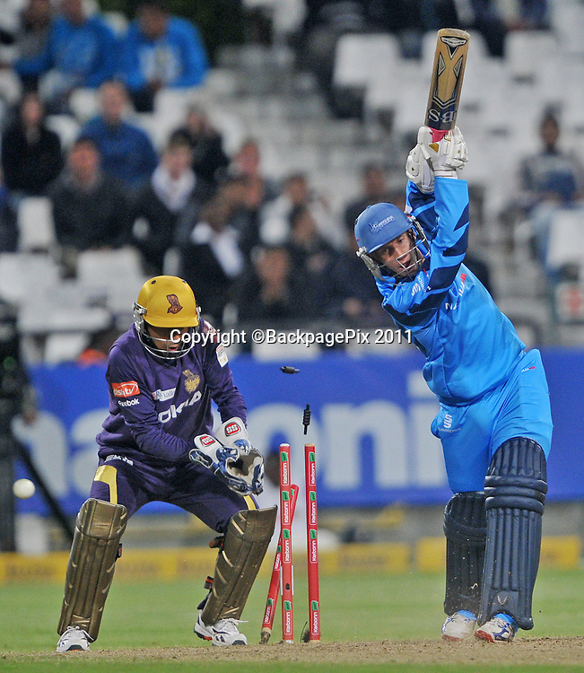 Eden Links of the Titans is bowled by Sunil Narine of the Kolkata Knight Riders to end the game during the 2012 Champions League Twenty20 cricket match between the Kolkata Knight Riders and the Titans at Newlands in Cape Town on 21 October 2012 ©Ryan Wilkisky/BackpagePix