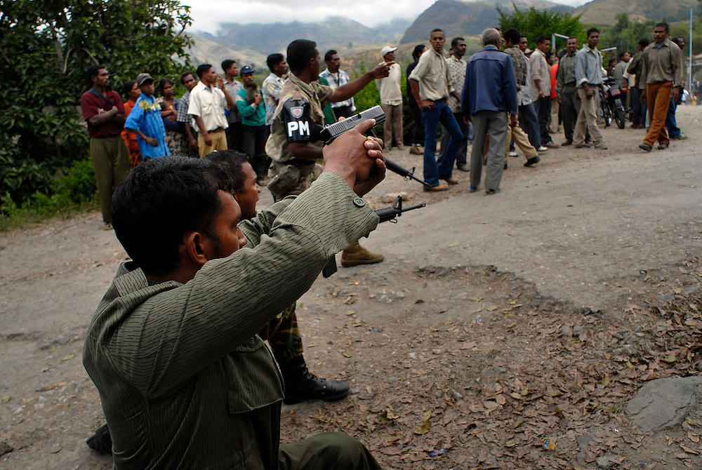 "Trouble erupts in Maubisse, East Timor,  11 June 2006. During a press conference in Maubisse by rebel leaders Major Alfredo Reinado and Manuel Tilman, gunfire is heard on the streets of Maubisse. Police fire into the there to dispurse rival gangs after a clash. ..During the press conference they announce they are planning a conference to seek ways of modifying East Timor's constitution to allow greater power for President Xanana Gusmao. Current Prime Minister Mari Alkitiri ""does not have the confidence of the people"" said Tilman. ""Time is the most dangerous weapon"" said Reinado."