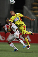 CAPE TOWN, SOUTH AFRICA - 11 FEBRUARY 2011, Wayne Arendse of Santos heads the ball clear as Thembinkosi Fanteni of Ajax Cape Town looks onduring the Absa Premiership match between Santos and Ajax Cape Town held at Athlone Stadium in Cape Town, South Africa..Photo by: Shaun Roy/Sportzpics
