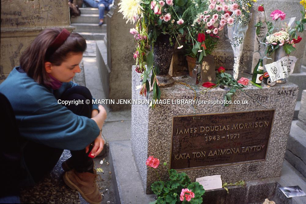 Grave of Doors lead singer Jim Morrison in the Pere Lachaise Cemetery Paris