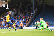 Leeds United Midfielder Kemar Roofe (7) has a shot saved by Southend United Goalkeeper Mark Oxley (1) during the Pre-Season Friendly match between Southend United and Leeds United at Roots Hall, Southend, England on 22 July 2018. Picture by Stephen Wright.