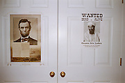 Posters of Abraham Lincoln and Osama bin Ladin adorn the bedroom closet of Peter Eich, 14, on January 25, 2010 in Chesapeake, Virginia.