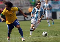 JUNE 09 2012:   Lionel Messi (10) of Argentina moves away from Marcelo (6) of Brazil during an international friendly match at Metlife Stadium in East Rutherford,New Jersey. Argentina won 4-3.