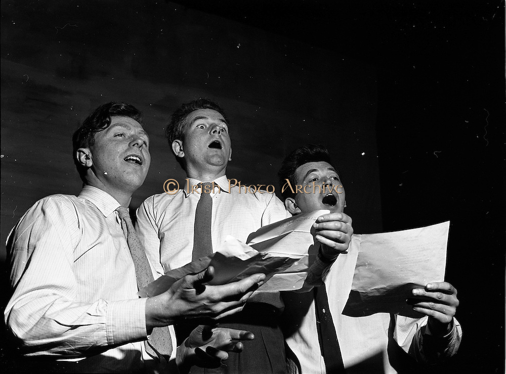 "26/05/1962<br /> 05/26/1962<br /> 26 May 1962<br /> Rehersal in Gael-Linn's Damer theatre in preparation for first ever review ""Damertásibh"", due to open on the 30th May. In a addition to ""Tontoletto"" a short play by Micheal Mac Liammóir, there were sketches by Niall Toibín;  Eoghan O Tuairisc; Sean O Riada and Tomas Mac Anna, dealing with subjects like the ""Playboy Movie"", Telefis Eireann, Lord Nelson and the Gael Linn Newsreel of 2062. Music was by Peadar O Briain and production was by Tomas Mac Anna. Picture shows (l-r) Antoine Ó Dalaigh; Annraoi Ó Braonain and Breandan Ó Dubhghaillas they appeared in the review Ilshiamsa an Damer."