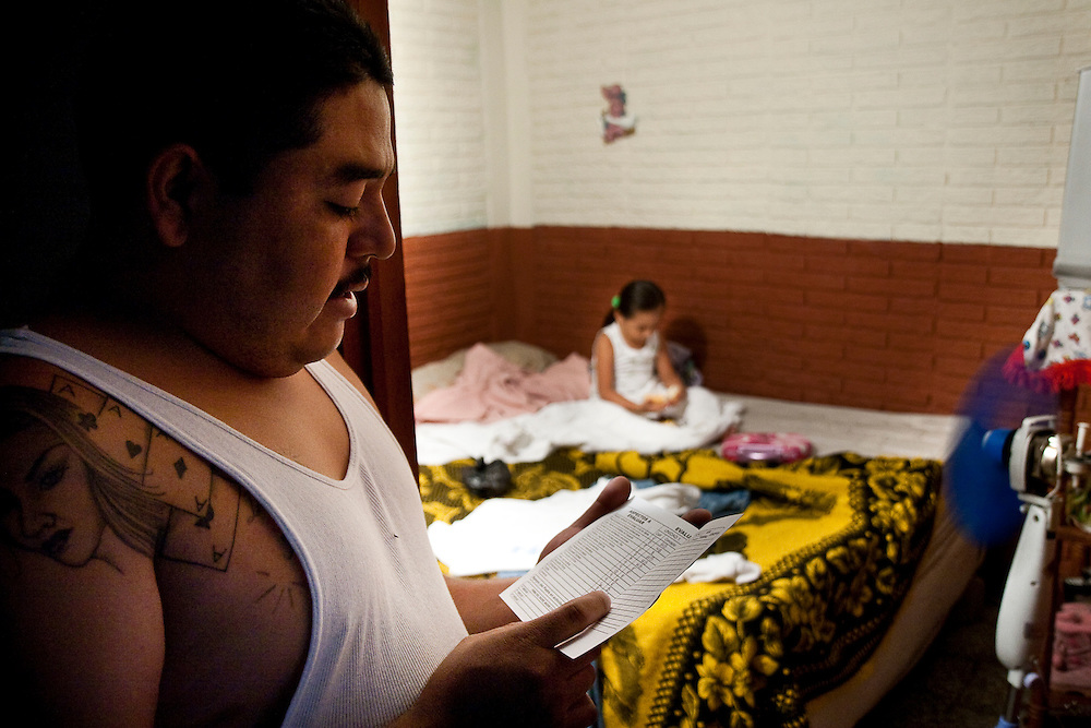 Jose, a long time member of 18th street, holds his daughters report card showing that she got a 9 out of 10 in English  in San Salvador.  He says he continues to live for her and wants to get out of the gang only to make sure he will stay alive for his daughter, but few gang members ever leave the lifestyle.