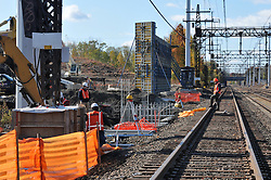 Setting Platform Foundations at Catenary Location. Railroad Station at Fairfield Metro Center CT. Flagman on Tracks, Northeast Corridor.