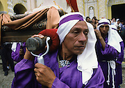 Holy Week. Good Friday. The most spectacular Holy Week throughout Latin America, a sort of time machine to find an ancient Spain, where roman soldiers with the faces of Maya peasants interpret for days a choral rite alive in the collective memory as a matter of chronicle. In theatrical scenery of Antigua, between colonial palaces and Baroque churches uncovered by frequent earthquakes and eruptions of nearby volcanoes, processions come one after the other in an increasingly spasmodic crescendo until Holy Friday. From dawn to sunset for thousands of penitents, curucuchos rigorously dressed in purple, is a privilege, often passed down from father to son, to load on the shoulders heavy groups of statues with Jesus Christ, God, the Holy Spirit and the Virgin Mary.