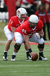 20 October 2012:  Matt Brown under center Pete Cary during an NCAA Missouri Valley Football Conference football game between the Missouri State Bears and the Illinois State Redbirds at Hancock Stadium in Normal IL