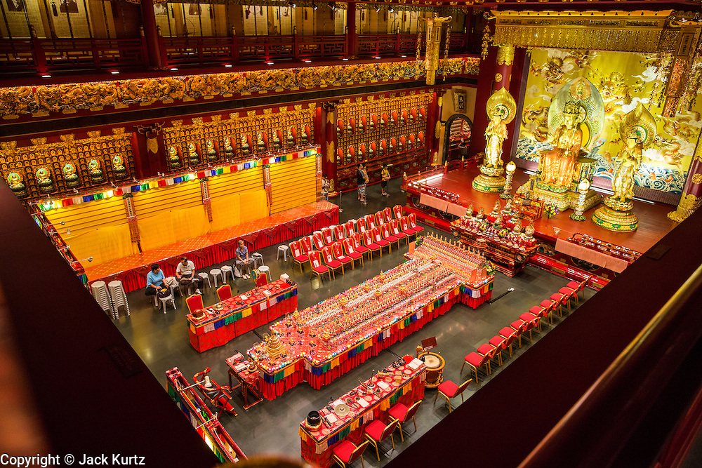 "16 DECEMBER 2012 - SINGAPORE, SINGAPORE: The main prayer hall at the Buddha Tooth Relic Temple and Museum in the Chinatown section of Singapore. The temple houses a sacred Buddha tooth relic. It is a ""Mahayana"" Buddhist temple, the larger of the two Buddhist sects. Mahayana Buddhism is practiced in India, China, Vietnam (northern), Japan, Tibet, Mongolia, Korea and in Chinese immigrant communities around the world.      PHOTO BY JACK KURTZ"