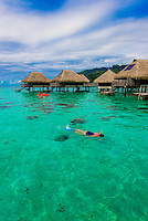 Lagoon view and overwater bungalows, Hilton Moorea Lagoon Resort, island of Moorea, French Polynesia.