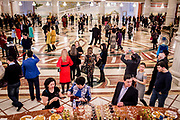 Theatre goers mingle before a performance at the Astana Opera, in Astana, Kazakhstan. Officially named The State Opera and Ballet Theatre, the Astana Opera is the third biggest in the world.