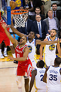 Golden State Warriors forward Kevon Looney (5) attempts to block a shot by Houston Rockets guard Eric Gordon (10) during Game 3 of the Western Conference Finals at Oracle Arena in Oakland, Calif., on May 20, 2018. (Stan Olszewski/Special to S.F. Examiner)