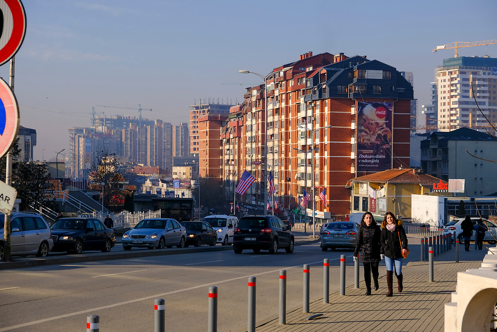 Two women walking past US flags flying on the street George Bush Boulevard (Xhorxh Bush) on the 13th of December 2018, in Pristina, the capital and largest city of Kosovo, it has a mainly Albanian population along with other smaller communities.  The street was named in honour of the US president to show appreciation for the military support received from the US during the Kosovo war with Yugoslavia.  (photo by Andrew Aitchison / In pictures via Getty Images)