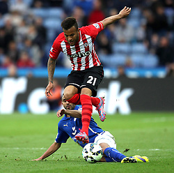 Southampton's Ryan Bertrand rides the tackle of Leicester City's Riyad Mahrez - Photo mandatory by-line: Robbie Stephenson/JMP - Mobile: 07966 386802 - 09/05/2015 - SPORT - Football - Leicester - King Power Stadium - Leicester City v Southampton - Barclays Premier League