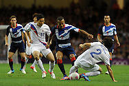 GB's Ryan Bertrand © is blocked by OH Jaesuk (2). London 2012 Olympic games, mens Olympic football, quarter final match, Great Britain v South Korea at the Millennium Stadium in Cardiff on Saturday 4th August 2012. pic by Andrew Orchard, Andrew Orchard sports photography,