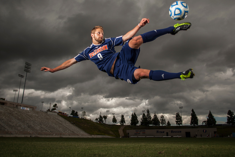 4/26/12 4:31:24 PM --- SOCCER PORTRAIT SPORTS SHOOTER ACADEMY 009 --- Cal State Fullerton Soccer player Jordan Wolff (9)  jump kicks a ball  during a portrait session at Titan Stadium on the campus of Cal State Fullerton on April 26, 2012. Photo by Mat Boyle, Sports Shooter Academy