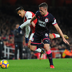 Jonathan Hogg of Huddersfield muscles Alexis Sanchez of Arsenal off the ball during Arsenal vs Huddersfield, Premier League, 29.11.17 (c) Harriet Lander | SportPix.org.uk