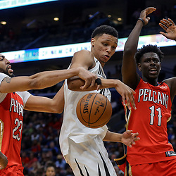 Apr 4, 2018; New Orleans, LA, USA; Memphis Grizzlies forward Ivan Rabb (10) loses the ball as New Orleans Pelicans forward Anthony Davis (23) and guard Jrue Holiday (11) defend during the second half at the Smoothie King Center. The Pelicans defeated the Grizzlies 123-95. Mandatory Credit: Derick E. Hingle-USA TODAY Sports