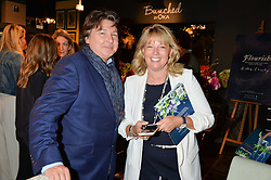 ANDREW & KAREN HOWES at a party to celebrate the publication of Flourish by Willow Crossley held at OKA, 155-167 Fulham Rd, London on 4th October 2016.