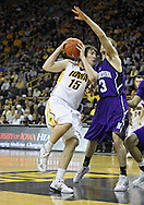 January 12 2010: Iowa Hawkeyes forward Zach McCabe (15) tries to get around Northwestern Wildcats forward Mike Capocci (3) during the first half of an NCAA college basketball game at Carver-Hawkeye Arena in Iowa City, Iowa on January 12, 2010. Northwestern defeated Iowa 90-71.