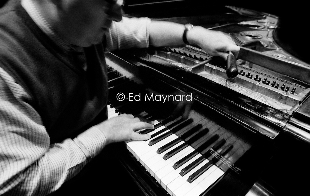 Piano tuner Paul Chrimes, a member of the Association of Blind Piano Tuners, works on an instrument at the Grand Theatre, Wolverhampton, England, UK.