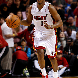 March 3, 2011; Miami, FL, USA; Miami Heat point guard Mario Chalmers (15) during a game against the Orlando Magic at the American Airlines Arena. The Magic defeated the Heat 99-96.    Mandatory Credit: Derick E. Hingle