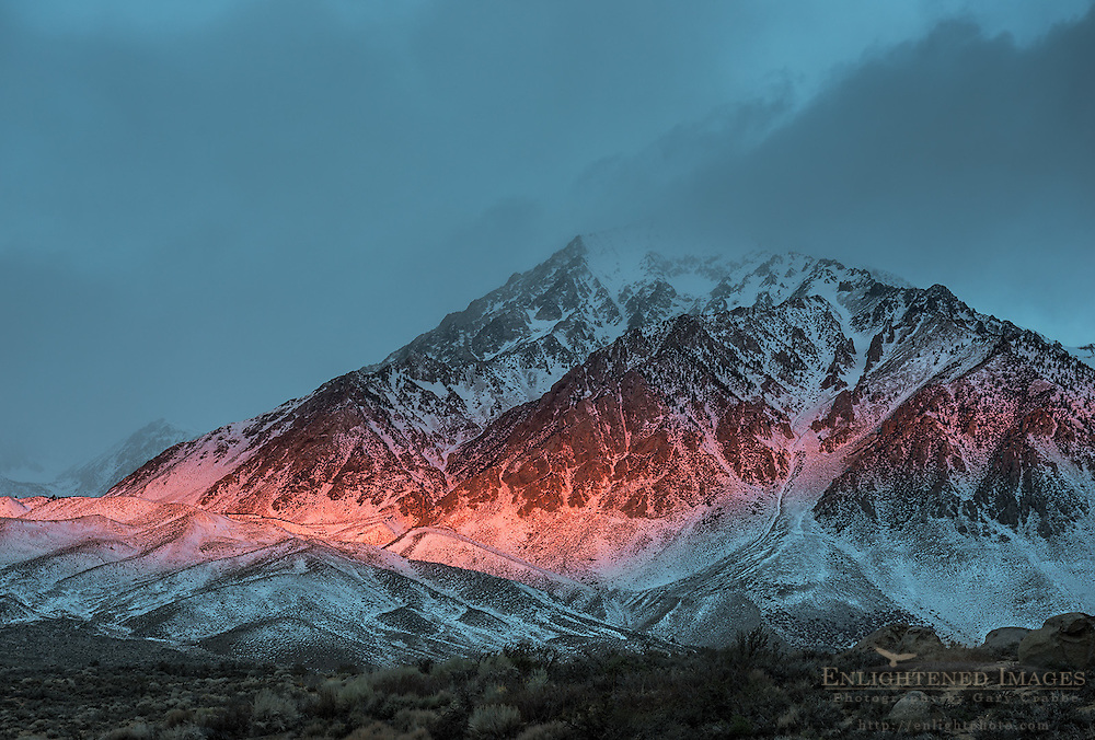 Alpenglow at sunrise through storm clouds on Mount Tom, Inyo County, Eastern Sierra, California