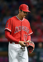 June 6, 2018 - Anaheim, CA, U.S. - ANAHEIM, CA - JUNE 06: Los Angeles Angels of Anaheim pitcher Shohei Ohtani (17) is pulled from the game and heads off the filed in the fifth inning of a game against the Kansas City Royals played on June 6, 2018 at Angel Stadium of Anaheim in Anaheim, CA. (Photo by John Cordes/Icon Sportswire) (Credit Image: © John Cordes/Icon SMI via ZUMA Press)