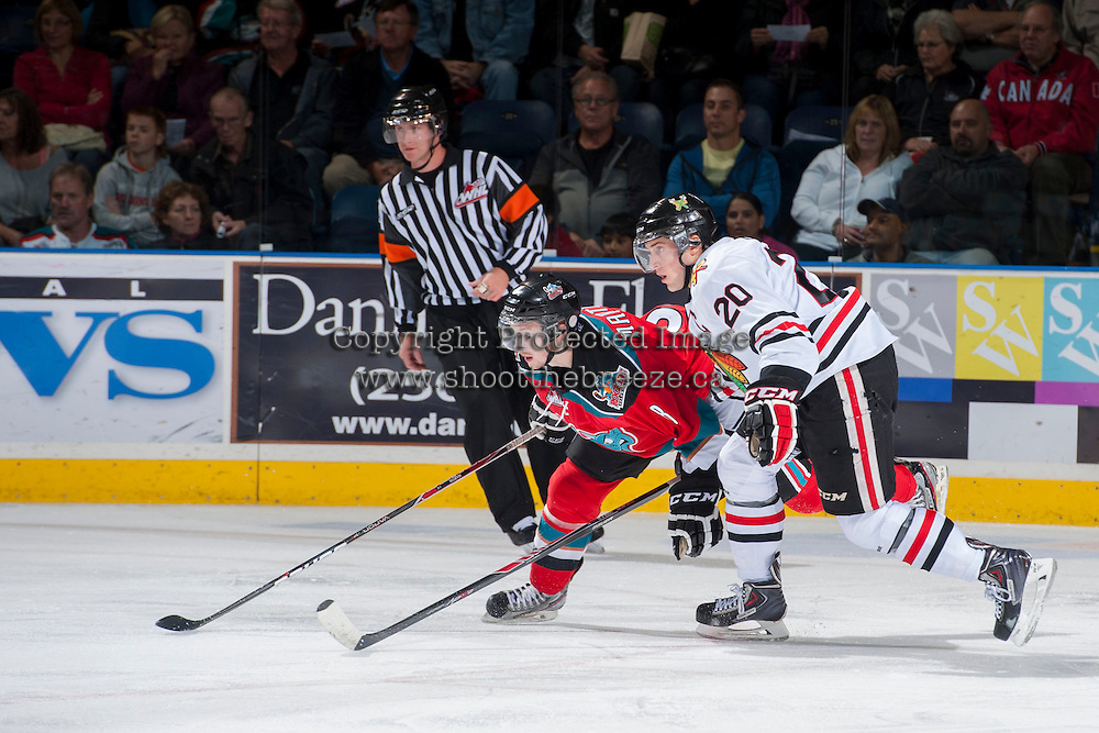 KELOWNA, CANADA - OCTOBER 4:  Taylor Leier #20 of the Portland Winterhawks checks Cole Martin #8 of the Kelowna Rockets  at the Kelowna Rockets on October 4, 2013 at Prospera Place in Kelowna, British Columbia, Canada (Photo by Marissa Baecker/Shoot the Breeze) *** Local Caption ***