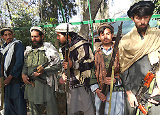 FEB 11 2013 Taliban militants attend a surrender ceremony