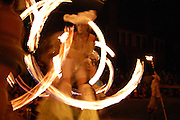 Fire dancers tracing flaming circles at Marking the Summer Solstice on the University of Arizona campus in Tucson.